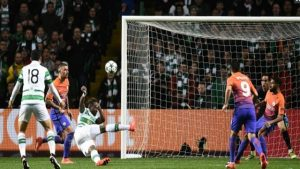 Manchester City's goalkeeper Claudio Bravo (2R) watches as Celtic's striker Moussa Dembele (3L) scores his team's third goal during the UEFA Champions League football match.