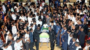 Members of the St George's College and Jamaica College Manning Cup teams form a guard of honour as pall-bearers remove the casket of Dominic James from the Holy Trinity Cathedral Church yesterday.