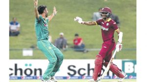 Pakistan bowler Sohail Khan (left) celebrates after bowling out West Indies' Evin Lewis (out of picture) as West Indies' Darren Bravo (right) reacts during the third T20I cricket match between Pakistan at the Sheikh Zayed Cricket Stadium in Abu Dhabi, yesterday